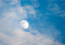 Moon. Blue sky with clouds and moon Stock Photo