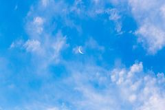 Moon on a blue sky with clouds Royalty Free Stock Images