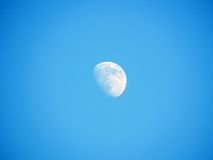 Moon on blue sky. Before the night royalty free stock photography