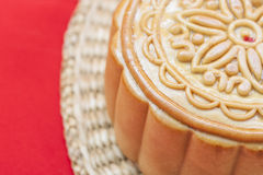 Moon cake on a bamboo mat. Chinese moon cake on a bamboo mat Royalty Free Stock Image