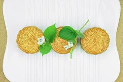 Moon cake, Chinese dessert present in modern fusion style. Stock Photos