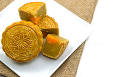 A moon cake, Chinese dessert on white plate  on white background Stock Image