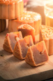 Moon cake. Chinese mid autumn festival dessert on wood board with dramatic morning scene royalty free stock photography
