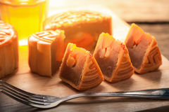 Moon cake. Chinese mid autumn festival dessert on wood board with dramatic morning scene stock images