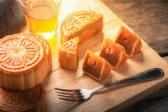 Moon cake. Chinese mid autumn festival dessert on wood board with dramatic morning scene stock image