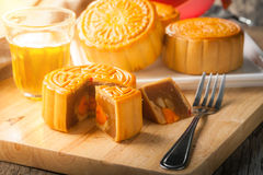 Moon cake. Chinese mid autumn festival dessert on wood board with dramatic morning scene royalty free stock photo