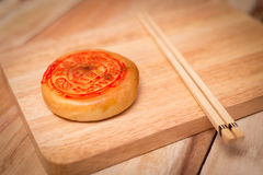 Moon cake,Chinese mid autumn festival dessert. on wooden table Royalty Free Stock Photos