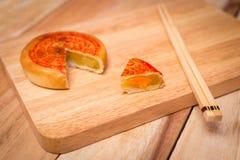 Moon cake,Chinese mid autumn festival dessert. on wooden table Stock Image