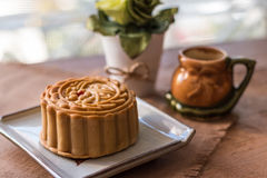 Moon cake. Chinese mid autumn festival  on white plate with wooden board background. Closeup, Select focus stock images