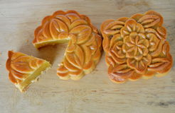 Moon cake Chinese tradition dessert in festival on chop block Royalty Free Stock Image