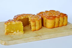 Moon cake Chinese tradition dessert in festival on chop block. Moon cake Chinese tradition dessert in festival on  wooden chop block Royalty Free Stock Image