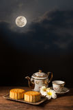 Moon Cake. Chinese Moon cake under full moon stock photo