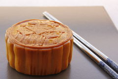 Moon cake. With the chopsticks Royalty Free Stock Photo