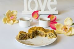 Moon cake, food for Vietnamese mid autumn festival. Focus on moon cake and others are blurred.  Stock Image
