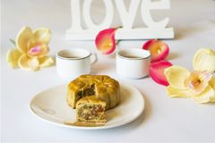 Moon cake, food for Vietnamese mid autumn festival. Focus on moon cake and others are blurred.  Royalty Free Stock Image