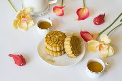 Moon cake, food for Vietnamese mid autumn festival. Focus on moon cake and others are blurred.  Royalty Free Stock Photography