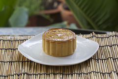 Moon cake with golden lotus seed and egg yolk filling Stock Photos