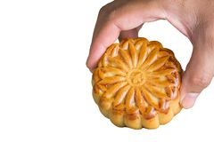 Moon cake. Hand hold on Moon cake on white background - food for chinese mid autumn festival Stock Photography