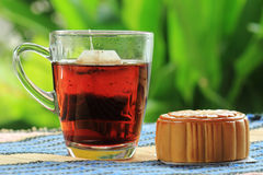 Moon cake and Hot Tea Stock Photos