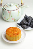 Moon cake with tea and water caltrop Royalty Free Stock Image