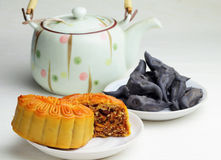 Moon cake with tea and water caltrop Royalty Free Stock Photos