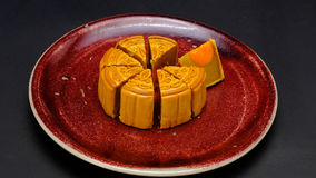 Moon-cake. A traditional chinese pastry, eaten during the harvest moon festival in october, is composed of durian, sweet bean and almond slices fillings, with royalty free stock photo
