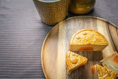 Moon cake on wooden plate Stock Photo