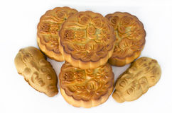 Moon cakes. Mooncakes stacked with piglet cakes by the side, isolated white background stock photography