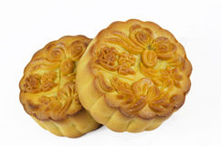 Moon cakes. Mooncake cutted with lotus seed paste and yolk inside, isolated white background Royalty Free Stock Photography