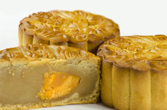 Moon cakes. Mooncake cutted with lotus seed paste and yolk inside, isolated white background royalty free stock image