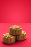Moon cakes for the Chinese Mid-autumn festival. Red background Royalty Free Stock Photography