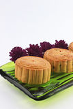 Moon cakes and purple chrysanthemums Royalty Free Stock Images