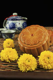 Moon cakes and tea, decorated with chrysanthemum Royalty Free Stock Photo
