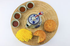 Moon cakes and tea on wicker tray Royalty Free Stock Photography