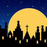 Moon cats. Cats watching the moon rise from rooftops Royalty Free Stock Photo