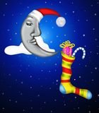 Moon and Christmas stocking Royalty Free Stock Images