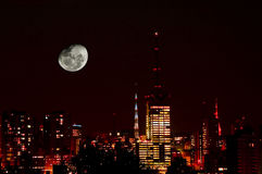 Moon in city skyline Royalty Free Stock Photo