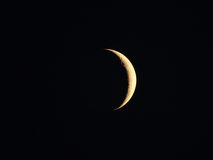 Moon in a clear night sky Royalty Free Stock Image