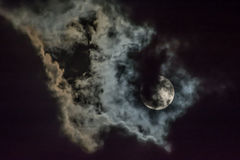 Moon and cloud Stock Images