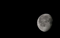 Moon during cloudless night. View from Earth at the Moon through 500mm lens Royalty Free Stock Image