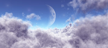 Moon among the clouds Royalty Free Stock Photos