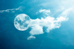 Moon between the clouds Stock Images