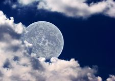 The moon in clouds Stock Images