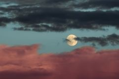 Moon with clouds Royalty Free Stock Images