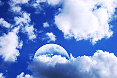 Moon and clouds. Blue sky with moon and beautiful cloudscape Royalty Free Stock Photo