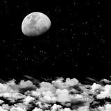 Moon and clouds background. Image can be used for backgrounds for many things like posters, presentations etc Stock Image