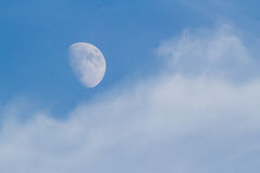 Moon, Clouds, and Blue Sky Royalty Free Stock Images