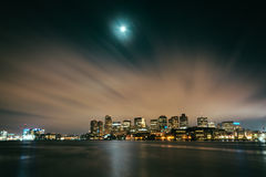 The moon and clouds moving through the sky over the Boston skyli Stock Photo