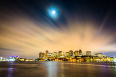 The moon and clouds moving through the sky over the Boston skyli Stock Images