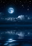 Moon and clouds in the night Royalty Free Stock Image